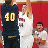 WARREN DILLAWAY / Star Beacon<br /> MATT FITCHET (44) of Edgewood leaps to block a shot by Conneaut's Christian Williams with Edgewood's Connor McLaughlin (background) fighting for rebound position on Friday night at Edgewood.