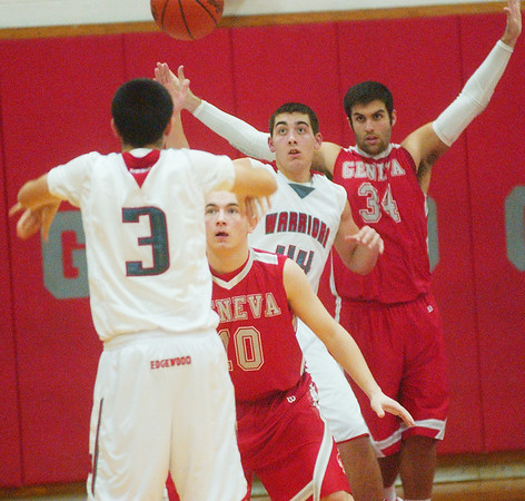 WARREN DILLAWAY / Star Beacon<br /> CONNOR MCLAUGHLIN (3) of Edgewood passes the ball to teammate Matt Fitchet (44) as Geneva's Brandon Kovach (10) and Eric Juncker (34) defend on Tuesday night at Edgewood.