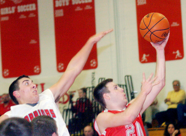 WARREN DILLAWAY / Star Beacon<br /> VERN THOMPSON (20) of Geneva drives to the basket with Edgewood defender Matt Fitchet close behind on Tuesday night at Edgewood.