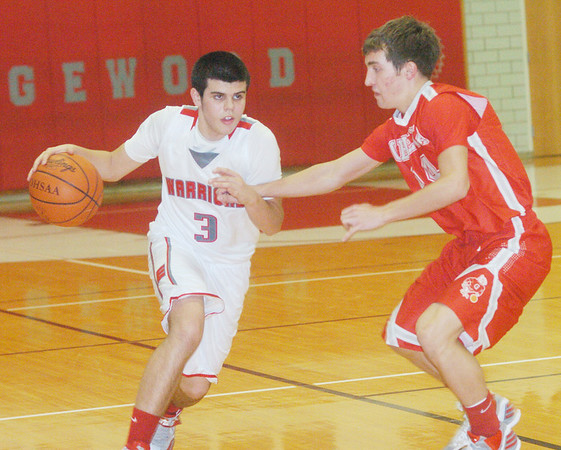 WARREN DILLAWAY / Star Beacon<br /> CONNOR MCLAUGHLIN (3) of Edgewood drives to the basket as Geneva's Steve Jewell defends on Tuesday at Edgewood.