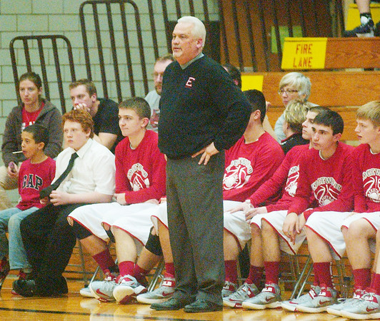 WARREN DILLAWAY / Star Beacon<br /> JOHN BOWLER, Edgewood boys basketball coach, watches the action on Tuesday night during a home game with Geneva.