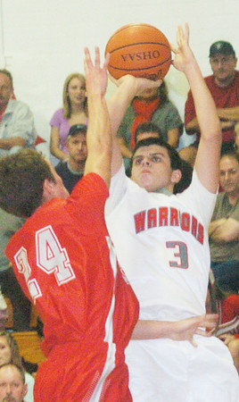 WARREN DILLAWAY / Star Beacon<br /> CONNOR MCLAUGHLIN (3) of Edgewood shoots over Geneva's Steve Jewell  on Tuesday at Edgewood.
