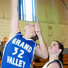 WARREN DILLAWAY / Star Beacon<br /> HOLLY NYE of Grand Valley shoots a layup with Mackenzie Stenroos of St. John following the play on Saturday at Mahoney Gymnasium in Ashtabula.