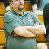 WARREN DILLAWAY / Star Beacon<br /> DAVE MCCOY, Edgewood girls basketball coach, watches the action on Saturday night at Conneaut.