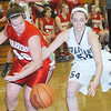 WARREN DILLAWAY / Star Beacon<br /> COURTNEY HUMPHREY (42) of Edgewood and Angie Zappitelli (54) of Conneaut battle for the ball on Saturday night at Conneaut.