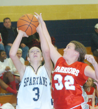 WARREN DILLAWAY /  Star Beacon<br /> GIA SATURDAY of Edgewood attempts to block a shot by Conneaut's Natalie Bertolosio (3) of Conneaut on Friday night at Conneaut.