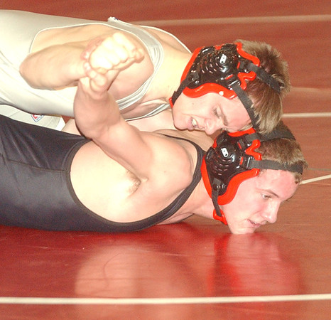 WARREN DILLAWAY / Star Beacon<br /> JEROEN ELLIS (top) of Edgewood wrestles Ricker Maple of Jefferson during a 138 pound bout at Jefferson.