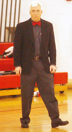 WARREN DILLAWAY / Star Beacon<br /> TOM AVSEC, Jefferson wrestling coach, watches the action on Thursday during a home match with Edgewood.