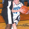 WARREN DILLAWAY / Star Beacon<br /> JOEY FERRANTE of St. John collides with a Saint Martin de Porres player on Saturday at Mahoney Gymnasium in Ashtabula.