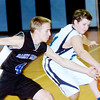 WARREN DILLAWAY / Star Beacon<br /> FOSTER FRENCH (4) of Saint Martin de Porres battles for the ball with St. John's Zach Taylor on Saturday at Mahoney Gymnasium in Ashtabula.