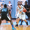 WARREN DILLAWAY / Star Beacon<br /> PAUL CALAWAY (15) of St. John grabs the bal between Saint Martin de Porres defenders Lowelle Hall (25) and Tyrone Johnson (1) on Saturday at Mahoney Gymnasium in Ashtabula.