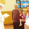 WARREN DILLAWAY / Star Beacon<br /> FATHER RAYMOND THOMAS (left) offers a blessing to the unborn during a Mass For Life Saturday morning at St. Joseph Church in Ashtabula. The service coincides with the Jan. 23, 1973, U.S. Supreme Court decision that legalized abortion in the United States. The service affirms the church's belief against abortion. (From left on right) Patrick, Marlo and Mae (2) Ruane and Jake and Valerie Harchalk.