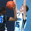 WARREN DILLAWAY / Star Beacon<br /> PAUL CALAWAY (15) of St. John defends Deonte Robeson of Saint Martin de Porres on Saturday at Mahoney Gymnasium in Ashtabula.