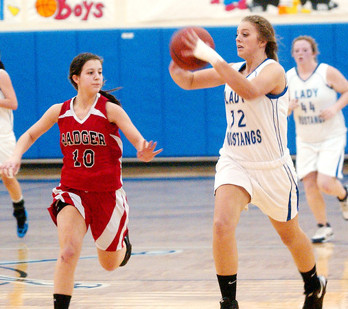 WARREN DILLAWAY / Star Beacon<br /> HOLLY NYE of Grand Valley prepares to pass as Badger's Stacey Elser (10) defends on Monday night in Orwell.