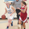 WARREN DILLAWAY / Star Beacon<br /> JESSICA VORMELKER (12) of Grand Valley dribbles up court with Badger's Holly Masters defending on Monday night in Orwell.