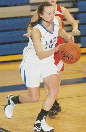 WARREN DILLAWAY / Star Beacon<br /> KELLY PRESKE of Grand Valley dribbles to the basket on Monday night during a home game with Badger.
