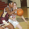 WARREN DILLAWAY / Star Beacon<br /> ARIANN BARILE (44) of Jefferson defends Liberty's Sade Burnett on Thursday at Jefferson.