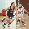 WARREN DILLAWAY / Star Beacon<br /> DEANNA COMP (22) of Jefferson defends Liberty's Leah Leshnack on Thursday at Jefferson.