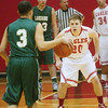 WARREN DILLAWAY / Star Beacon<br /> VERN THOMPSON (20) of Geneva defends Lakeside's Will Anderson on Friday night at Geneva.