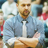 WARREN DILLAWAY / Star Beacon<br /> MARK TAYLOR, Lakeside boys basketball coach, keeps a close eye on the action on Friday night at Geneva.