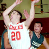 WARREN DILLAWAY / Star Beacon<br /> VERN THOMPSON (20) of Lakeside drives to the basket in front of Lakeside's Nick Meola (back right) on Friday night at Geneva.