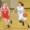 WARREN DILLAWAY / Star Beacon<br /> CYDNIE WHETRO (11) of Lakeside dribbles up court with Cardinal's Christine Morris (10) close behind on Monday at Lakeside.