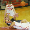 WARREN DILLAWAY / StarBeacon<br /> NICK BLOOD of Conneaut passes the ball to a teammate from his back in front of Geneva's David Smalley (44) on Tuesday night at Geneva.