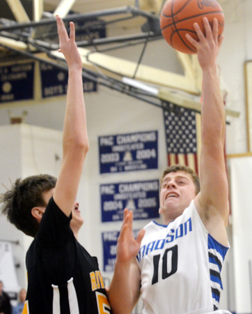 WARREN DILLAWAY / Star Beacon<br /> AARON PETRUCELLI (10) of Madison drives to the basket with Jeremy Janota (left) of  Riverside defending on Friday night at Madison.