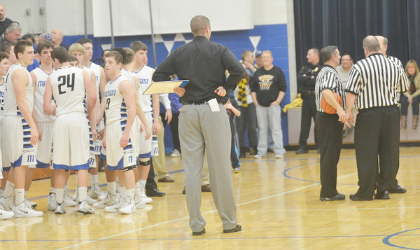 WARREN DILLAWAY / Star Beacon<br /> ADAM MAY (back to camera), Riverside boys basketball coach, and the Madison team wait for a call from officials after a last second three pointer brought the Beavers within one point of Riverside on Friday night at Madison.