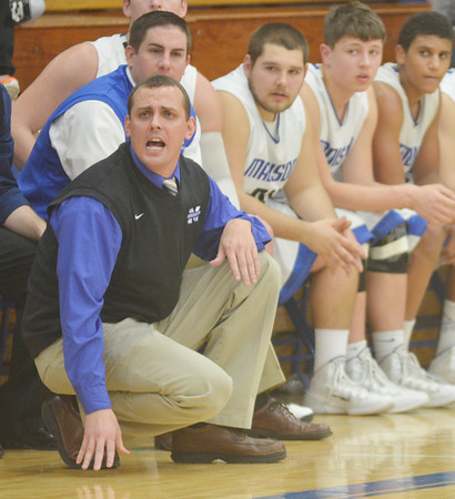 WARREN DILLAWAY / Star Beacon<br /> PAT MORAN, Madison basketball coach, and his bench watch the waning moments of a one point victory over Riverside on Friday night at Madison.