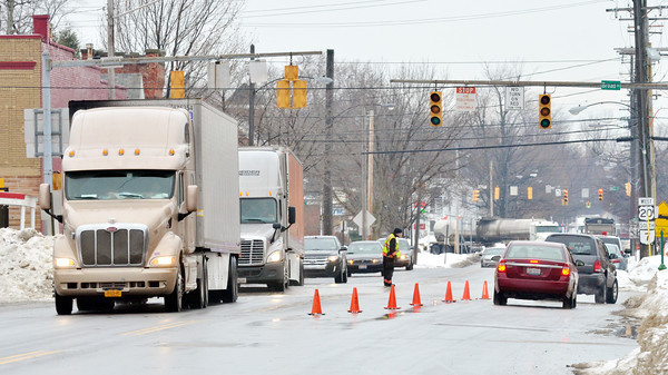 WARREN DILLAWAY / Star Beacon<br /> ROUTE 20 continued to be a busy road on Friday as traffic was diverted from Interstate 90 through  Conneaut after a truck damaged a bridge over Interstate 90 on Pond Road in Springfield Township, Pa.