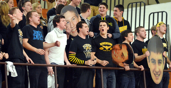 WARREN DILLAWAY / Star Beacon<br /> RIVERSIDE FANS get the basketball team fired up on Friday at Madison.