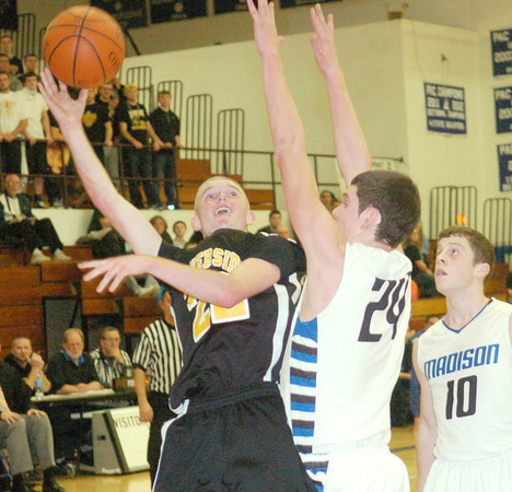 WARREN DILLAWAY / Star Beacon<br /> AUSTIN HESS (left) of Riverside shoots as David Albert of Madison (24) defends on Friday night at Madison.