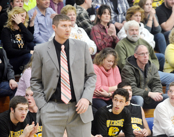 WARREN DILLAWAY / Star Beacon<br /> ADAM MAY, Riverside boys basketball coach, watches the action onn Friday night at Madison.