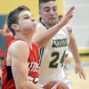 WARREN DILLAWAY / Star Beacon<br /> LUCAS HITCHCOCK of Jefferson drives to the basket with Kyle Downs of Lakeside in hot pursuit on Saturday night at Lakeside.