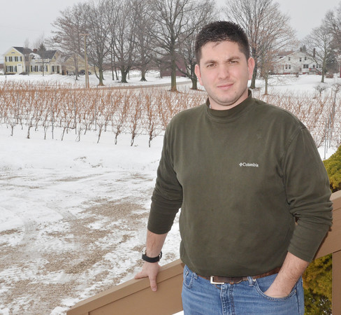 WARREN DILLAWAY / Star Beacon<br /> MATT MEINEKE, owner of MCellars Winery in Harpersfield Township, is hoping the recent extreme cold spell didn't damage too much of the 2014 grape crop.