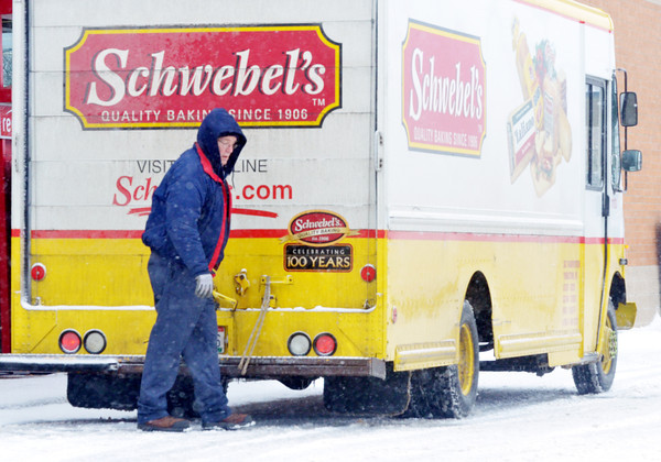 DELIVERY DRIVERS, like this one at the Ashtabula Walgreen's, braved frigid temperatures during the recent blast of cold weather.