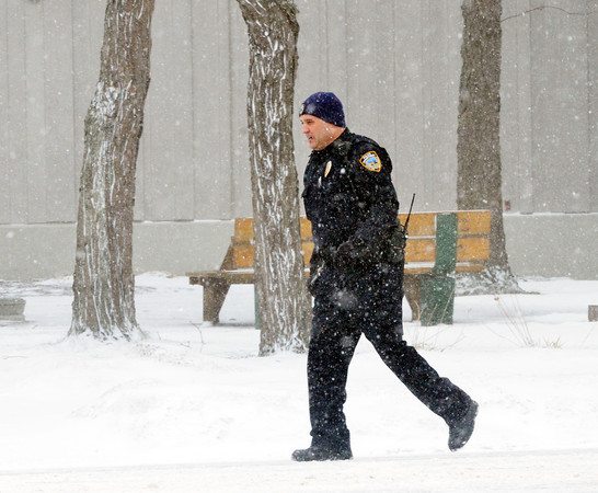 TERRY TULINO, an Ashtabula police officer, investigates a traffic crash on Lake Avenue during a recent blast of cold weather.