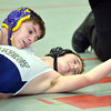 WARREN DILLAWAY / Star Beacon<br /> NATE WALKER (top) of Berkshire goes for the pin of Vince Nolan of Conneaut during a 113 pound bout at Edgewood on Saturday morning.
