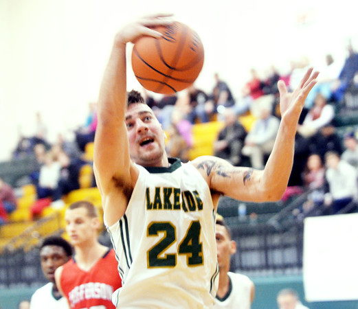 WARREN DILLAWAY / Star Beacon<br /> KYLE DOWNS of Lakeside pulls down a rebound on Saturday night during a home game with Jefferson.