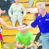 WARREN DILLAWAY / Star Beacon<br /> CODY CHARVAT (left) of Berkshire receives congratulations from his coach after registering his 100th high school wrestling win on Saturday at Edgewood.
