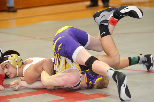 WARREN DILLAWAY / Star Beacon<br /> ISAIAH NGAIRAIGAS (left) of Conneaut pins Will Blechschmid of Berkshire during a 120 pound bout on Saturday at Edgewood.