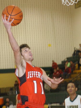 WARREN DILLAWAY / Star Beacon<br /> SAGE CANTINI of Jefferson drives to the basket on Saturday night at Lakeside.