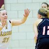 WARREN DILLAWAY / Star Beacon<br /> GEENA GABRIEL (21) of Pymatuning Valley defends Maddie Williams (12) of Mathews  on Monday evening in Andover Township.