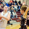 WARREN DILLAWAY / Star Beacon<br /> GEENA GABRIEL (21) of Pymatuning Valley drives to the basket with Paula Sponsler (20) and Dayna Ellis (25) follow the play  on Monday evening in Andover Township.
