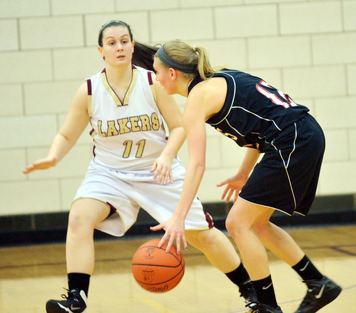 WARREN DILLAWAY / Star Beacon<br /> TAYLOR LIPINSKY (11) of Pymatuning Valley defends Maddie Williams (12) of Mathews  on Monday evening in Andover Township.