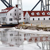 WARREN DILLAWAY / Star Beacon<br /> THE OHIO DEPARTMENT OF NATURAL RESOURCES ASHTABULA DIVISION OF WATERCRAFT HEADQUARTERS is reflected in the Ashtabula River on Monday.