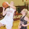 WARREN DILLAWAY / Star Beacon<br /> GEENA GABRIEL (21) of Pymatuning Valley drives to the basket with Marena Wolford (4) of Mathews defending on Monday evening in Andover Township.