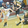 WARREN DILLAWAY / Star Beacon<br /> GEENA GABRIEL (21) of Pymatuning Valley picks up a loose ball and drives to the basket with Marissa O'Dell (on floor) and Mathews teammate Bry McClurg (23), both of Mathews, follow the play  on Monday evening in Andover Township.