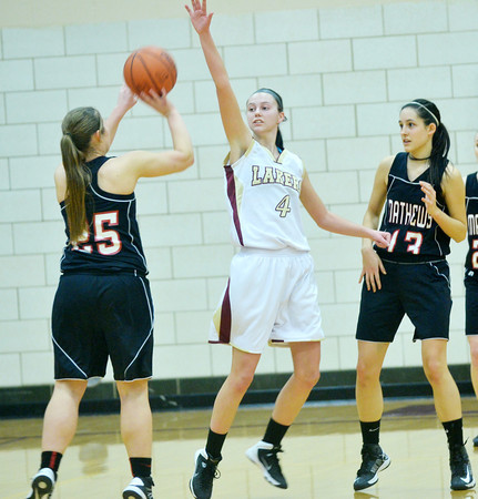 WARREN DILLAWAY/ Star Beacon<br /> ABBY HAMILTON (4) of Pymatuning Valley defends Dayna Ellis (25) of Mathews while her teammate Natalie Halarick (13) looks on Monday evening in Andover Township.